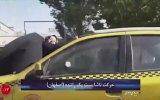 Karısını Cezalandırmak İçin Kaput Üzerinde Gezdiren İranlı Taksici