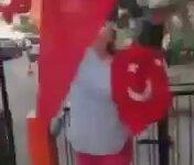 Parti Bayrağı Yanındaki Türk Bayraklarını Alan Teyze