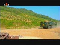 Kuzey Kore Televizyonu Gururla Mars-14 Füzesini Sunar