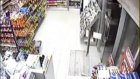 Thugs backed up by police attacking Jawad 24 Hours supermarket