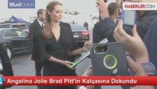 Angelina Jolie'nin Brad Pitt'in Kalçasını Ellemesi