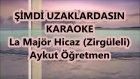 Şimdi Uzaklardasın La Majör Hicaz Karaoke Md Altyapısı Şarkı Sözü