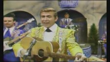 Buck Owens & His Buckaroos  - I've Got A Tiger By The Tail