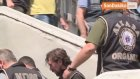 Gözaltına Alınan Tanju Çolak, Kelepçelerle Adliyeye Sevk Edildi
