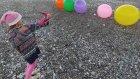 Plajda 5 büyük balon ve nerf Ok ile vurmaca